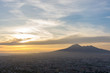 Overview of Naples and its Vesuvius while someone paragliders