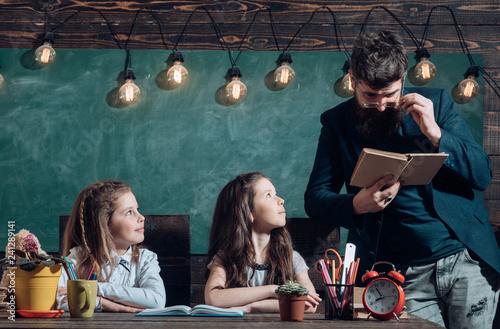 Valokuva  Educational concept - schoolchildren in a classroom