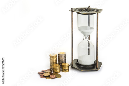 Fotografie, Obraz  Hourglass clock with coins. Time is money concept