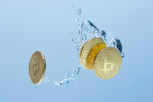 Concept. Bitcoin Going Down. Bitcoin Gold Coins Drowning In Water. Bitcoin In Water.