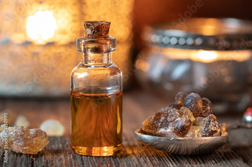 Photo  A bottle of frankincense essential oil with frankincense resin crystals