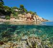 Spain Costa Brava rocky coast with fish underwater