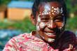 Leinwanddruck Bild - Girl with traditionally painted face, Madagascar