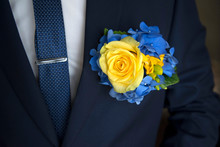 Yellow Rose Boutonniere On Black Suit