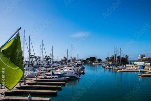 Fotografie, Obraz  Small marina with beep blue water and many sail and power boats docked in slips