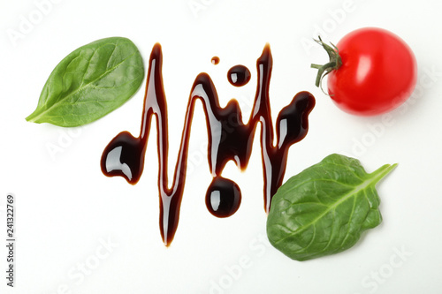 Composition with balsamic vinegar isolated on white, top view