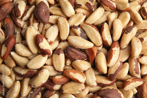 Many delicious Brazil nuts as background, top view
