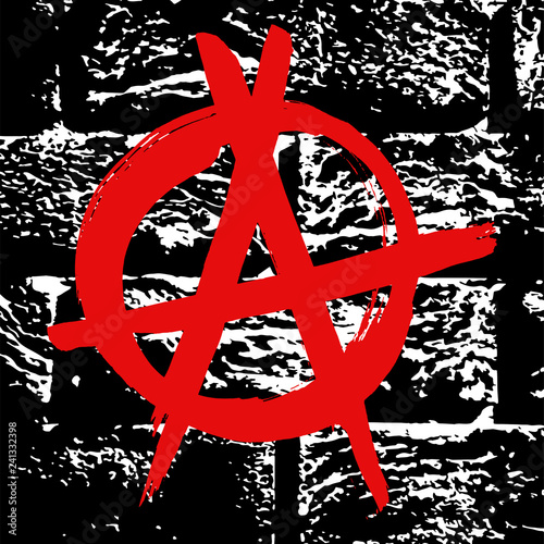 Valokuva  Black and white grunge brick wall  texture with red ink hand drawn symbol of anarchy