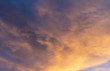Clouds during sunset. The sky is dyed golden colors.