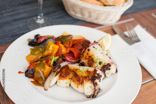 Fotografie, Obraz  Delicious grilled calamari squid with vegetable on plate