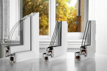 Samples Of Modern Window Profiles On Table Indoors. Installation Service