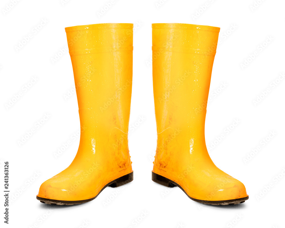 Fototapeta Yellow rubber boots isolated on white background. Dirty boots. ( Clipping path )
