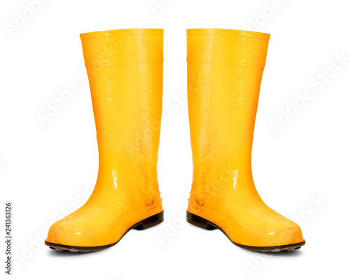 Fototapeta Yellow rubber boots isolated on white background. Dirty boots. ( Clipping path ) obraz