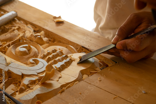 Wood carving in Thailand craftsman. Canvas-taulu
