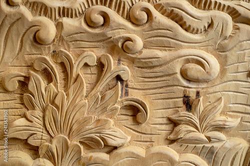 Valokuvatapetti Wood carving in Thailand craftsman.