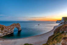 The Natural Arch Durdle Door At The Jurassic Coast In England After Sunset