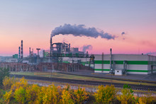 Pipes Of Woodworking Enterprise Plant Sawmill In The Morning Dawn. Air Pollution Concept. Industrial Landscape Environmental Pollution Waste Of Thermal Power Plant