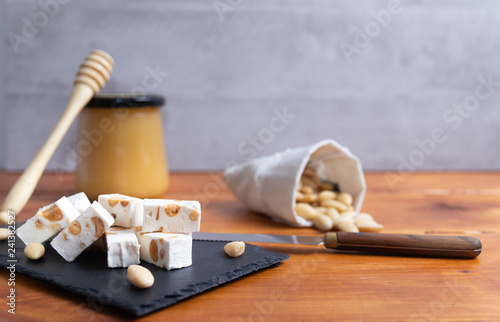 Fotografie, Obraz  Homemade nougat with honey and almonds.
