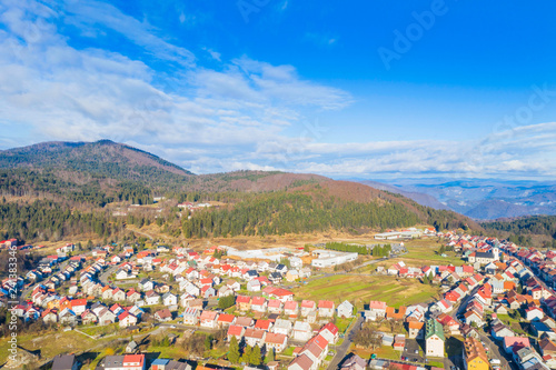 Croatia, Delnice, Gorski kotar, panoramic view of town center from drone in winter, mountain landscape in background
