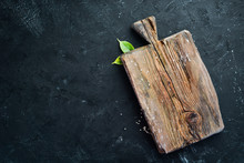 Kitchen Wooden Board On A Stone Background. On A Black Background.