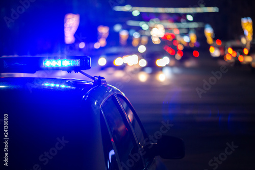 canvas print motiv - z1b : police car lights at night in city with selective focus and bokeh