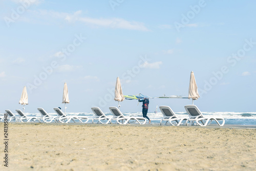 Fotografie, Obraz  Windsurfer with board on the Cyprus beach