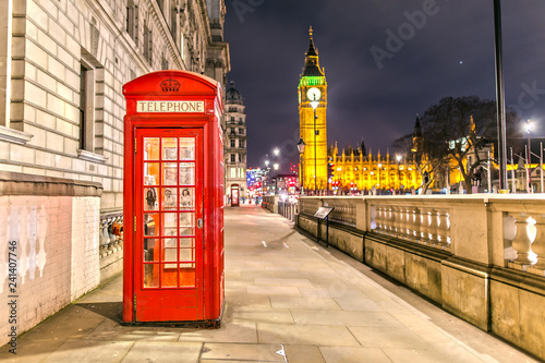 Foto op Canvas Londen rode bus Palace of Westminster in London with the Telephone Booth at Night
