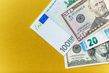 Background With American Dollar And Euro Bills.