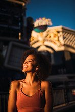 USA, Nevada, Las Vegas, Portrait Of Happy Young Woman In The City At Night