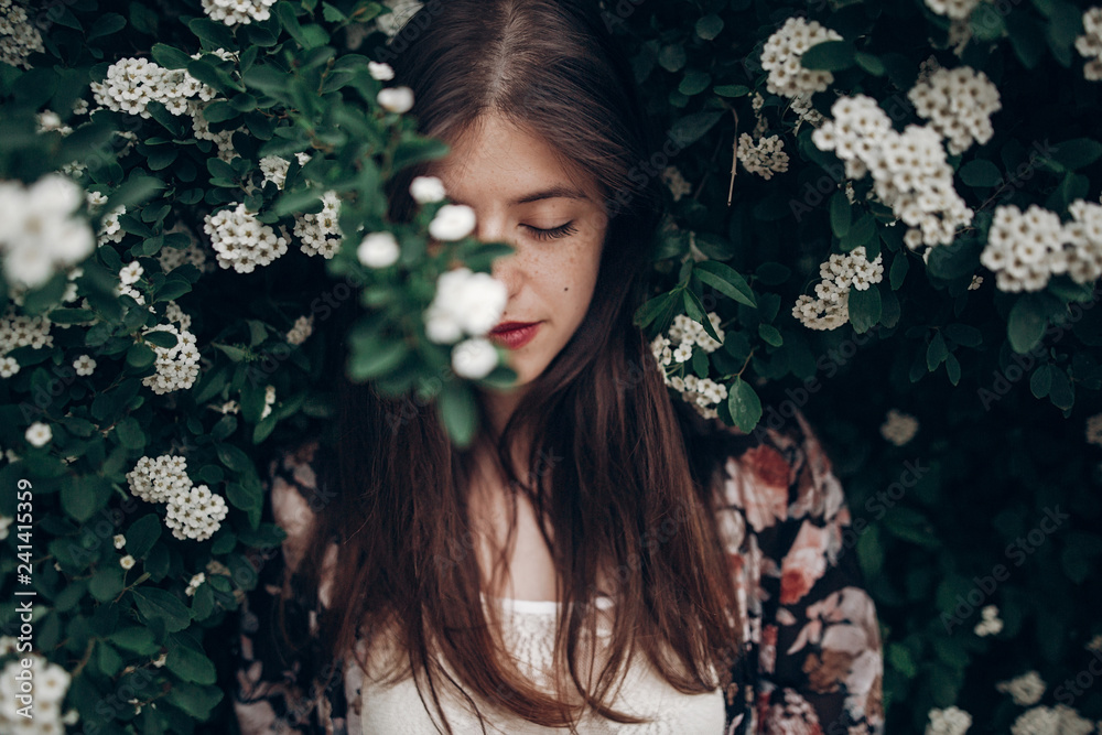 Fototapety, obrazy: calm portrait of beautiful hipster woman in blooming bush with white flowers of spirea. boho girl sensual portrait in floral modern clothes in greenery. space for text