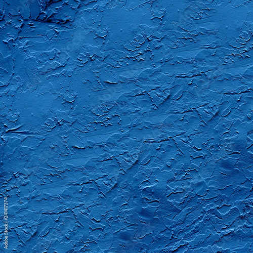 Fotografía  Rough dark blue plaster applied to the wall surface