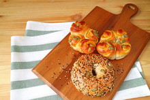 Breads With Pumpkin Seeds, Sunflower Seeds And Sesame In Different Types On Wooden Tray Served On The Table