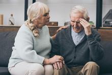 Retired Woman Sitting Near Senior Husband With Headache