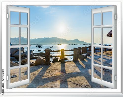 Fototapeta view of the window on the sea promenade