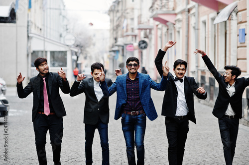 Group of 5 indian students in suits posed outdoor, having fun and dancing Wallpaper Mural