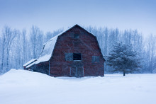 Old Barn In A Snow Storm Winte...