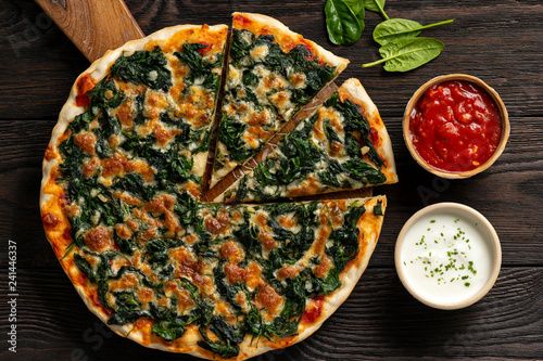 Homemade spinach pizza with mozzarella.