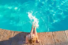 A Child Swims In A Swimming Po...