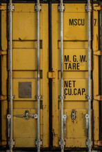 The Door Of An Old Yellow Cargo Shipping Container