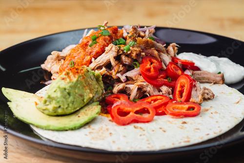 Fotografia, Obraz  Unwrapped burrito in plate on wooden table