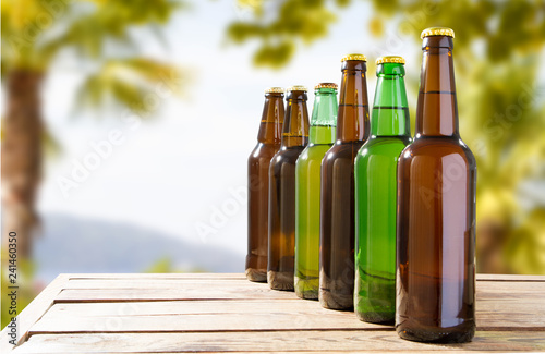 Foto op Canvas Bier / Cider beer bottles on a wooden table, festive drink