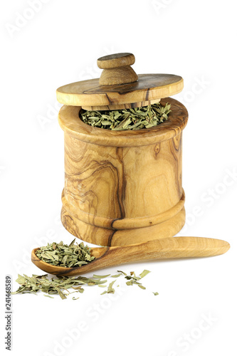 Foto op Canvas Kruiderij French tarragon in a wooden jar made of olive wood isolated on white background
