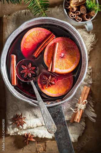 Hot and sweet mulled red wine with spices and spruce