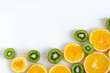 Fresh kiwi and orange sliced. Background for the profile, design, printing with fruit. The basis for the banner with orange and kiwi. Fresh and natkralnye vitamins. Healthy food. Flat lay, top view.