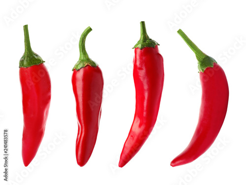 Wall Murals Hot chili peppers Set with fresh red chili peppers on white background