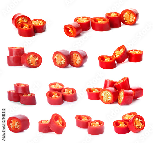 Set with cut fresh red chili peppers on white background