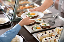 Woman Giving Plate With Healthy Food To Boy In School Canteen, Closeup