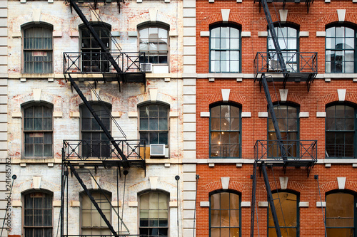 Plakat Close-up view of New York City style apartment buildings with emergency stairs along Mott Street in Chinatown neighborhood of Manhattan, New York, United States..