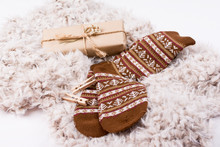 Closeup Of Winter Accessories. Brown Winter Socks, Fuzzy Scarf And Gift Box. Studio Lighting, No Retouch, Closeup.