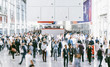canvas print picture - Crowd of people walking on a trade show in london